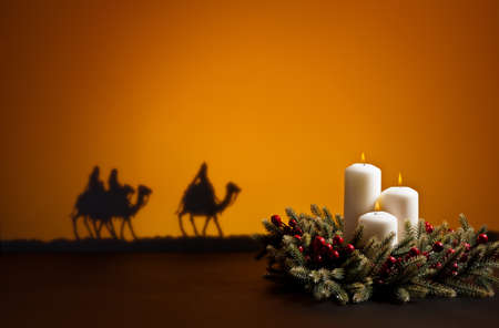 Frankincense: Three wise men on the way to Jesus in Bethlehem and candles Stock Photo