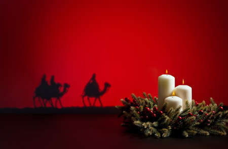 bible christmas: Three wise men on the way to Jesus in Bethlehem and candles Stock Photo