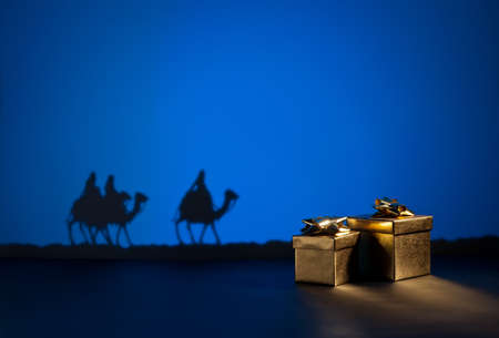 Three wise men on the way to Jesus in Bethlehem and presents