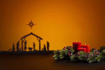 Birth Jesus silhouette of the crib in Bethlehem and candles