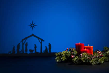 Birth Jesus silhouette of the crib in Bethlehem and candles photo