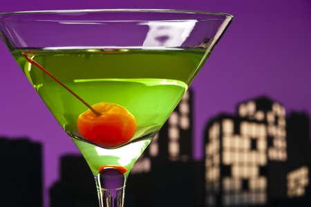 Metropolis Apple Martini cocktail in skyline setting photo