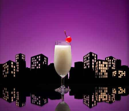 Metropolis Pina colada cocktail in city skyline setting photo