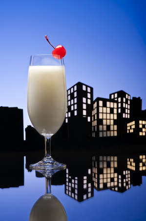 tropical drink: Metropolis Pina colada cocktail in city skyline setting