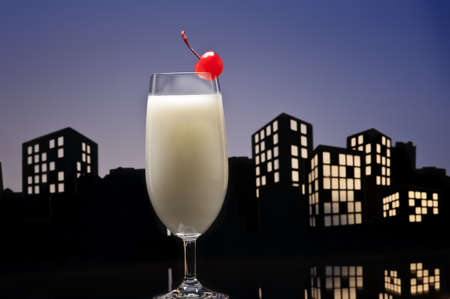 Metropolis Pina colada cocktail in city skyline setting