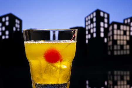 alcohol screwdriver: Skrew Driver cocktail in city skyline setting