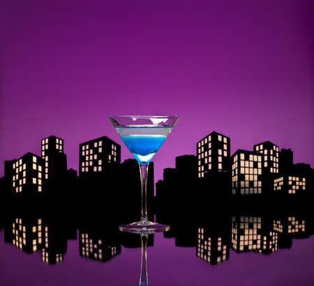 Metropolis Blue Martini cocktail in skyline setting photo