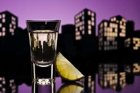 Tequila shoot in colorfull cityscape setting photo