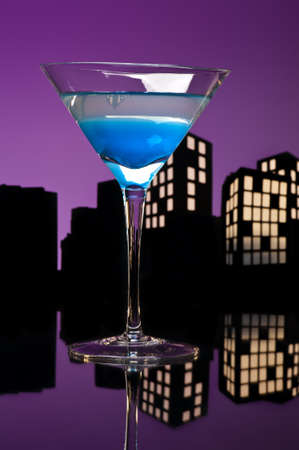Metropolis Blue Martini cocktail in skyline setting photo