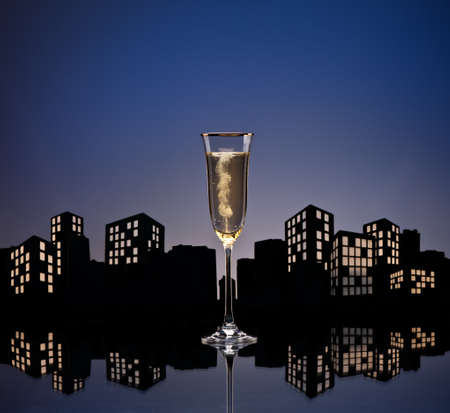 Metropolis Champagne cocktail in city skyline setting photo