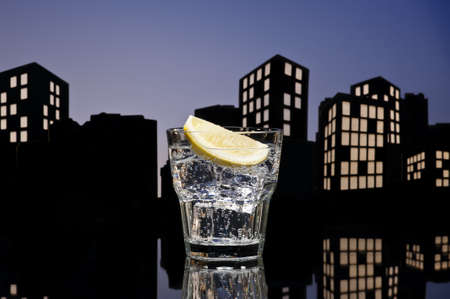tom collins: Metropolis Gin Tonic cocktail cocktail in city skyline setting