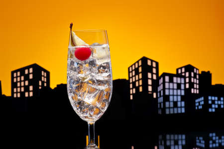 tom collins: Metropolis tom collins or Gin Tonic cocktail cocktail in city skyline setting
