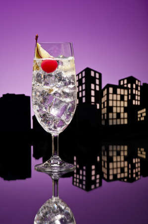 Metropolis tom collins or Gin Tonic cocktail cocktail in city skyline setting photo