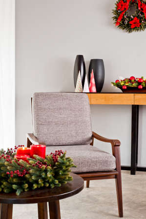Bright grey upholstered chair in advent decoration photo