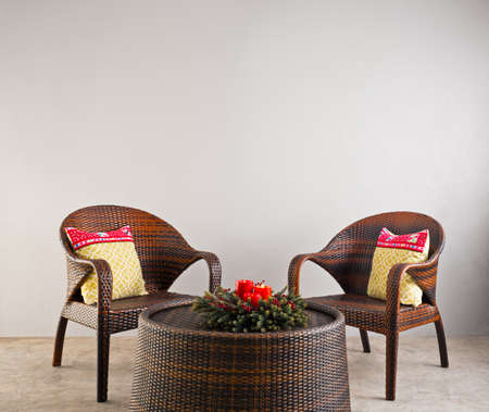 rattan: Brown rattan chairs and table and flowers