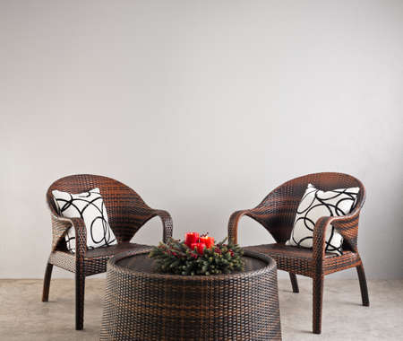 Two basket weaved seater in a lounge   photo