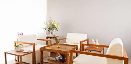 Three bright white seater in lounge area photo