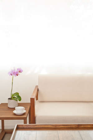 Bright white seater in lounge area with curtain
