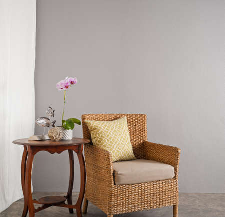 Rattan sofa chair in a patio garden lounge setting photo