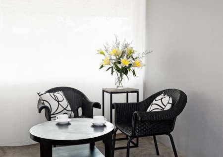 Dark outdoor furniture in a bright setting photo