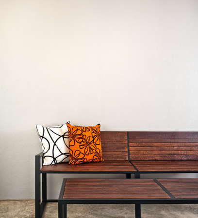 Garden bench as interior furniture with two pillow Stock Photo - 25837547