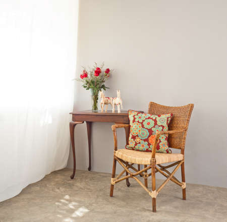 beige bast chair with luxurious side table photo
