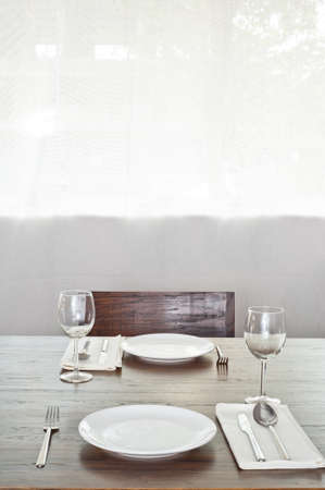 Bright simple dinner table setup for two photo
