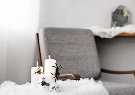 upholstered: Grey upholstered chair in Halloween setting with candles Stock Photo