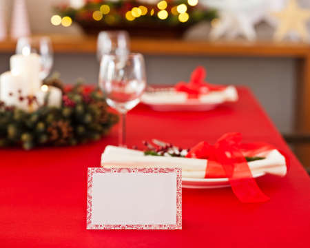 Red dinner table setup with name place card photo