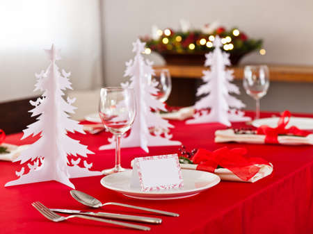 advent wreath: Christmas dinner table setting with name card in red
