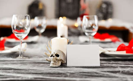 living skull: Halloween dinner table setting with  white place card