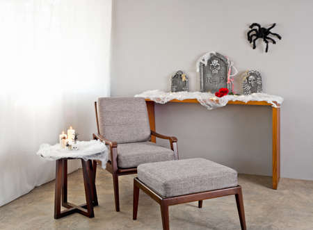 Grey upholstered chair in Halloween seting photo