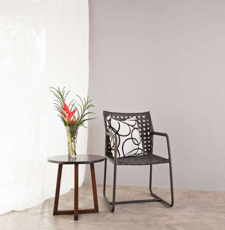 Garden furniture chair in simple setting and side table  photo