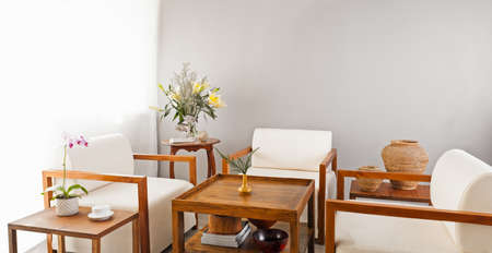 seater: Bright white seater in lounge area with coffee table