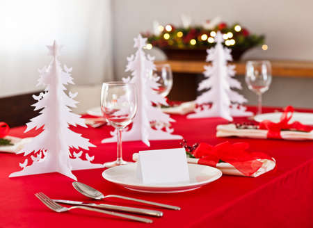 place card: Christmas dinner table setup with decoration on the side board