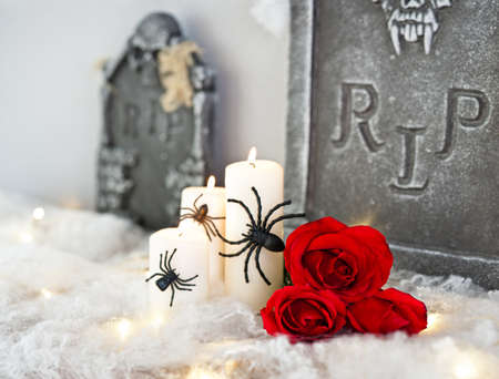 Candles in red grey Halloween decoration and roses   photo