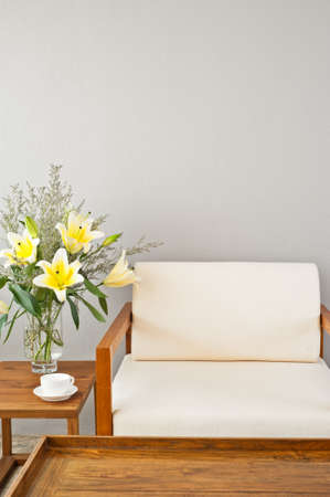 seater:  Bright white seater in lounge area and flowers
