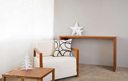 Bright sofa seat in grey bright setting photo