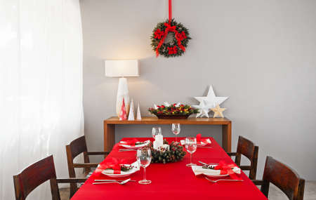 simple meal: Christmas dinner table setup with decoration on the side board
