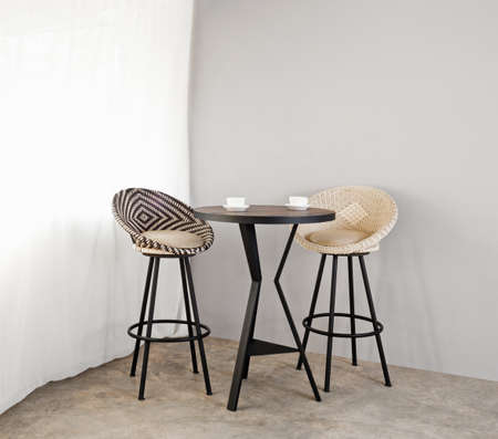 Bistro furniture as interior furniture black and white in color photo