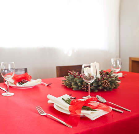 Christmas dinner table setup with advent decoration  photo