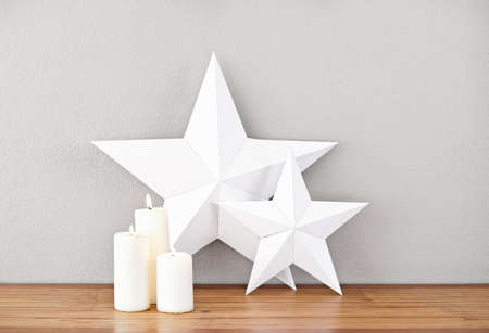 side table: Stars and lit candles on a side board as deco