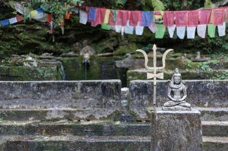 kathmandu: Shiva figure at a spring in Shivapuri Nagarjun National Park