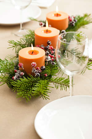 dinner table: Christmas Dinner table setting with orange candles Stock Photo