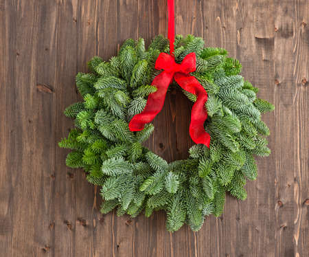 advent wreath: Advent wreath with red ribbon over a brown wooden plank