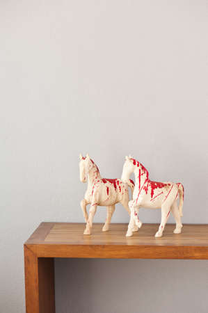 Wooden horse sculpture on a side board photo
