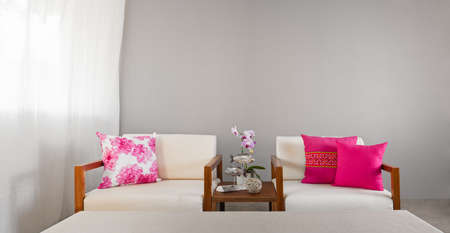 decoraton: Bright sofa seat in luxury interior decoraton with orchids