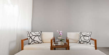 white sofa seat with pillows in bright color photo