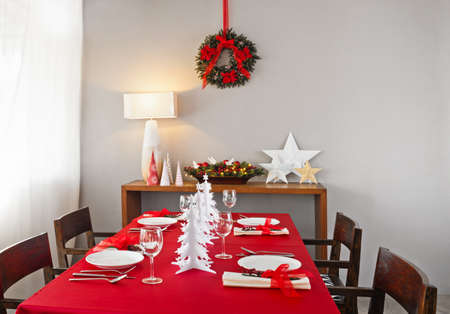 Christmas dinner table setup with decoration on the side board photo