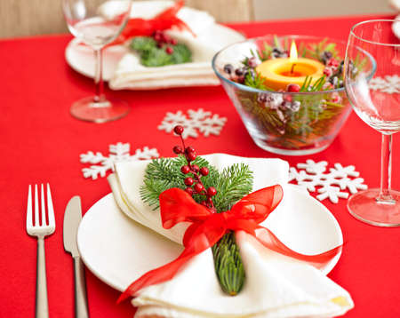 candle light dinner: Red Christmas dinner table setup with snow flake decoration
